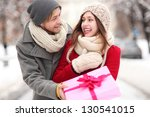 Man Giving Woman A Surprise Gift