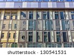 Facade of a building in a contemporary architecture style with the reflection of an old building opposite - stock photo
