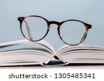 Reading Eyeglasses On Open Boo...