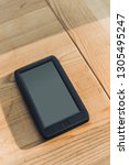 ebook with blank screen lying... | Shutterstock . vector #1305495247