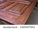 wood door manufacturing process.... | Shutterstock . vector #1305497041