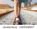 young woman walk in railway    Shutterstock . vector #1305508057