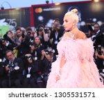lady gaga walks the red carpet... | Shutterstock . vector #1305531571