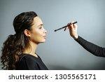 applying makeup. portrait of a...   Shutterstock . vector #1305565171