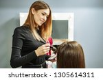 make up artist applying powder...   Shutterstock . vector #1305614311