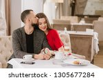 young and happy couple talking... | Shutterstock . vector #1305677284