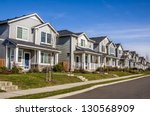 A Row Of New Townhouses Or...