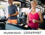 senior people running on a... | Shutterstock . vector #1305699487