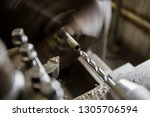 part machining with lathe  | Shutterstock . vector #1305706594