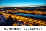 View of Barrandov Bridge over Vltava River in Branik, Prague, Czech Republic. Illuminated roads in cold winter evening.