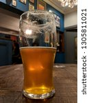 a pint of real ale  back lit by ... | Shutterstock . vector #1305811021