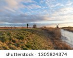 woman cycling in the dutch... | Shutterstock . vector #1305824374