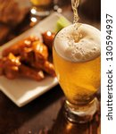 pouring beer with chicken wings ... | Shutterstock . vector #130594937