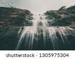 moody shot of waterfall.  | Shutterstock . vector #1305975304