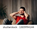 man covering ears protecting... | Shutterstock . vector #1305994144