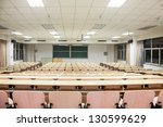 tables and chairs in a college... | Shutterstock . vector #130599629
