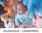 little baby in the swing.... | Shutterstock . vector #1306044061
