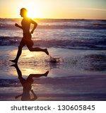 man running on the beach at... | Shutterstock . vector #130605845