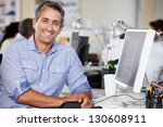 man working at desk in busy... | Shutterstock . vector #130608911