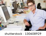 man working at desk in busy... | Shutterstock . vector #130608929
