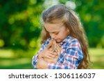 little cute girl with a rabbit | Shutterstock . vector #1306116037