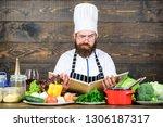 man bearded hipster read book... | Shutterstock . vector #1306187317