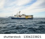 Seismic ship on sea waves. Oil research in ocean concept