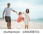 portrait happy family playing... | Shutterstock . vector #1306308721