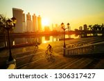 people jogging and biking... | Shutterstock . vector #1306317427