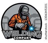 Welder Working With Weld Helme...