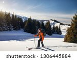 man skiing on fresh powder snow ... | Shutterstock . vector #1306445884