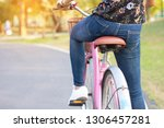 asian woman riding bicycle in...   Shutterstock . vector #1306457281