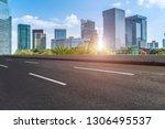 highway road and skyline of... | Shutterstock . vector #1306495537
