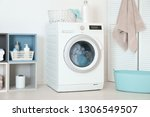 washing of different towels in... | Shutterstock . vector #1306549507