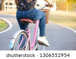woman cycling on street with...   Shutterstock . vector #1306552954