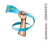 kazakhstan flag and hand on... | Shutterstock .eps vector #1306565371