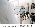 senior manager makes a report... | Shutterstock . vector #1306613617