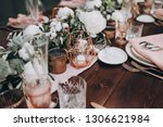 on wooden banquet table are... | Shutterstock . vector #1306621984