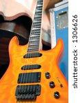 Orange electric guitar and flight case. - stock photo