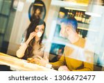 young couple at the bar... | Shutterstock . vector #1306672477
