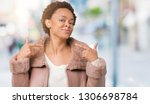 young african american woman... | Shutterstock . vector #1306698784