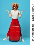a woman in a red skirt and... | Shutterstock . vector #1306740934