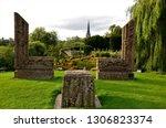 a view of a tall church spire... | Shutterstock . vector #1306823374