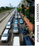 """Small photo of """"Jakarta, DKI Jakarta / Indonesia - Januari, 30th 2019: Long traffic at capital city of Indonesia. Jakarta suffers high traffic rate due to unbalanced raise of car compare to road construction."""""""