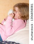 child with plush toy | Shutterstock . vector #1306858081