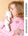 child with plush toy | Shutterstock . vector #1306858084