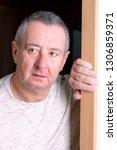 man is standing in the door | Shutterstock . vector #1306859371
