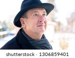 portrait of a senior with hat | Shutterstock . vector #1306859401