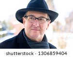 portrait of a senior with hat | Shutterstock . vector #1306859404