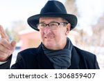finger pointing of man with hat | Shutterstock . vector #1306859407